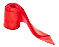 红色在白色隔绝的缎装饰丝带 库存照片
