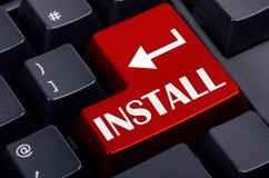 红色在键盘安装按钮 库存图片