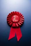 红色地方的奖蓝色背景的 免版税库存照片