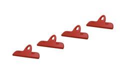 红色塑料夹子(纸夹) 免版税库存照片