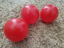 红色塑料小儿童的球  图库摄影