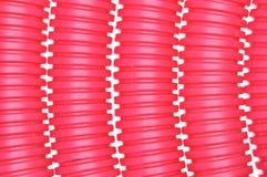 红色塑料波纹状的管子 免版税图库摄影