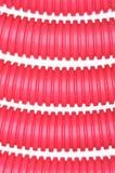 红色塑料波纹状的管子 库存照片