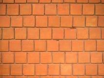 红色墙壁,方形的砖 库存图片