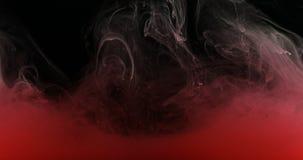 红色墨水油漆在创造液体艺术性的形状的水中 免版税库存图片