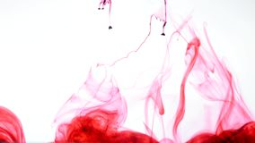 红色墨水在水中 摘要 库存图片
