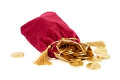 红色大袋和金黄欧元 免版税图库摄影