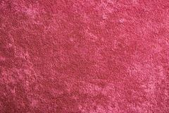 红色天鹅绒背景或丝绒法绒纹理做了棉花或羊毛与软的蓬松柔软光滑的缎织品布料阶 免版税库存图片