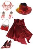 红色夫人的衣裳和辅助部件 免版税库存照片