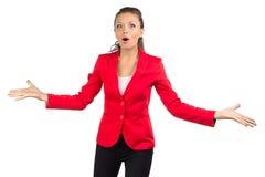 红色夹克的愉快的女实业家 免版税库存照片