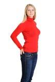 红色女衬衫的可爱的妇女 免版税库存图片