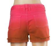 红色妇女牛仔裤短裤。后面 库存照片