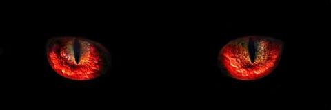 红色妖怪夜注视特写镜头 库存照片