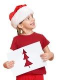 红色帽子的女孩有给圣诞老人的信件的-寒假圣诞节概念 免版税库存照片