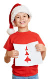 红色帽子的男孩有给圣诞老人的信件的-寒假圣诞节概念 免版税库存照片