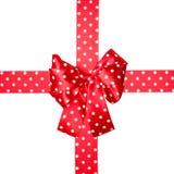 红色弓和丝带与由丝绸做的白色圆点 免版税库存照片