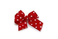 红色弓查出的由丝带制成在白色 库存图片