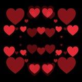 红色心脏和黑背景 免版税图库摄影