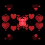 红色心脏和黑背景 免版税库存照片