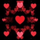 红色心脏和黑背景 免版税库存图片
