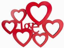 红色心脏照片框架,走下去站立isolaed白色背景 免版税库存图片