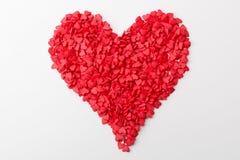 红色心脏由许多更小的心脏做成在白色背景 免版税库存图片