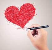 画红色心脏的男孩手 免版税库存照片