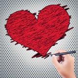 画红色心脏的男孩手 免版税库存图片