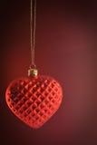 红色心脏装饰品垂悬 免版税图库摄影