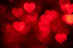 红色心脏bokeh背景照片,抽象假日背景 图库摄影