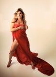红色性感的妇女 免版税图库摄影
