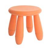 红色或橙色在白色隔绝的婴孩塑料凳子 库存照片