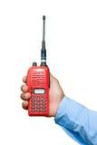 红色手提电话机收发器在手中 免版税图库摄影