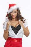 红色加工好的性感的圣诞老人妇女 免版税库存照片