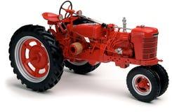 红色拖拉机白色 免版税库存图片