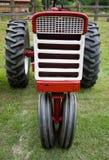 红色拖拉机白色 库存图片