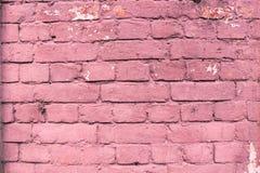 红色接近的都市砖墙背景 库存图片