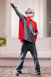 红色斗篷孩子客厅超级英雄 库存图片