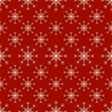 红色无缝的雪花样式 免版税库存图片