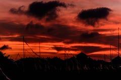 红色日落在巴厘岛 免版税图库摄影