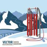 红色木雪撬 在冬天季节的山 免版税库存图片