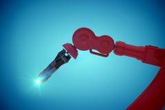 红色机器人爪3d特写镜头的综合图象  免版税库存图片