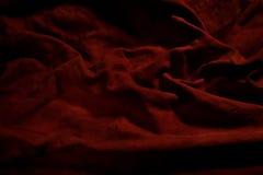 红色材料的背景 库存照片