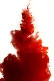 红色染料在水中 免版税库存照片