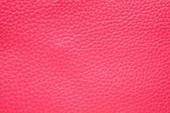 洋红色桃红色皮革背景 库存图片
