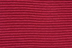 红色棉花镶边的编织的织品背景 库存图片