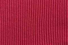 红色棉花镶边的编织的织品背景 免版税图库摄影