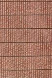 红色沙子石墙 库存图片