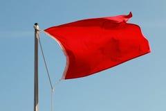 红色沙文主义情绪在蓝天上 图库摄影