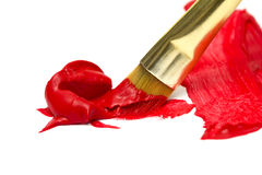 红色油漆金画笔 库存照片